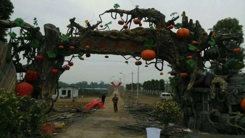 假树大门施工-仿古树大门设计-生态园大门建设