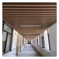 餐饮店仿木纹装饰吊顶U形铝方通格栅