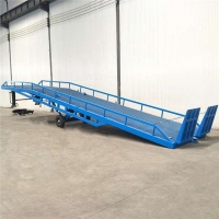 宁夏卸货平台手动液压登车桥液压升降机厂免费上门测量现场